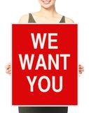 We Want You. An unrecognizable businesswoman holding a recruitment signboard Stock Image