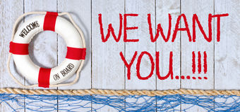 We want you, welcome on board. Lifebuoy with text on wooden background royalty free stock photography
