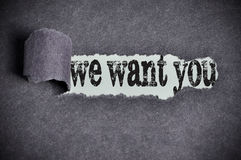 We want you word under torn black sugar paper Stock Photography