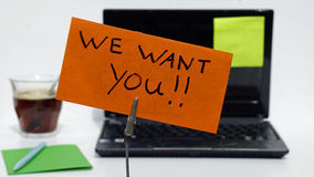 We want you. Written on a memo at the office royalty free stock image