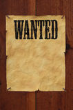 Wanted. Old western style wanted poster nailed to a plank fence with blank space for copy Royalty Free Stock Photography