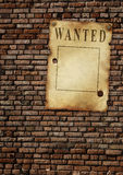 Wanted. The wild West. Old poster on brick wall Royalty Free Stock Photo