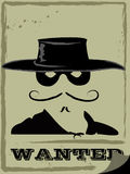 Wanted. Vector poster of the wanted criminal in the black hat and mask Stock Photography