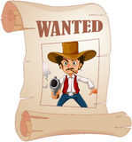 A wanted cowboy holding a gun at the poster Royalty Free Stock Photo