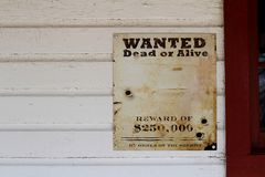 Wanted Dead or Alive Reward Poster. This is a blank sign waiting for your to put a face on the wanted poster.  Wanted dead or alive reward of $250,000 by order stock photo