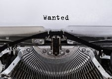 Wanted message typed on a old vintage typewriter. royalty free stock image