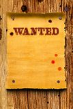 Wanted poster background. Wanted poster on wood texture background royalty free stock photography