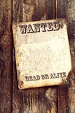 Wanted poster. Old wood background with faded wanted poster attached. Space for your text stock photography