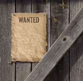 Wanted poster on weathered plank wood door royalty free stock photography