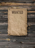 Wanted poster on weathered plank wood wall stock photo