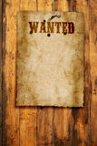 Wanted poster. Wild west wanted poster on wooden wall Royalty Free Stock Photo