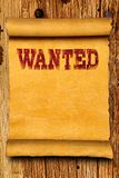 Wanted poster background. Wanted poster on wood texture background stock photo