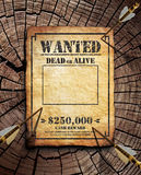 Wanted poster. On wooden surface royalty free stock photography