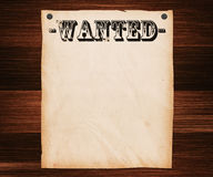 Wanted Poster on Wooden Wall Stock Photo
