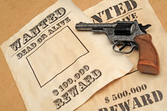 Wanted posters with gun Royalty Free Stock Photography