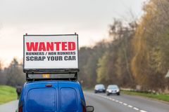 Wanted Runners Non Runners Scrap Your Car sign on car roof next to UK motorway.  stock images