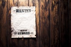 Wanted vintage poster with dramatic light. Wanted dead or alive reward poster stock image