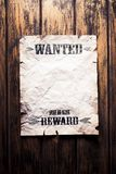 Wanted vintage poster with dramatic light. Wanted dead or alive reward poster stock photos