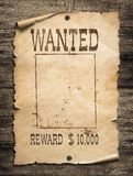 Wanted wild west poster on wood background. Wanted wild west poster on wood wall royalty free stock photography