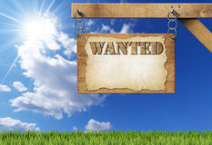 Wanted - Wooden Sign with Chain Stock Photo