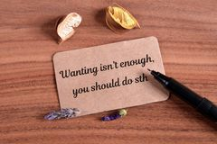 Wanting isn`t enough. You should do sth test write in card on wood royalty free stock images