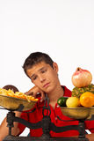 Wanting junk food. Teen  missing his junk food after a fruit diet Royalty Free Stock Images
