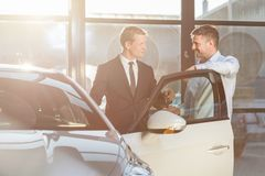 Wanting to buy new car. Young men wants to buy new car royalty free stock image