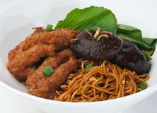 Wanton noodle, wanton noodle with chicken feet and mushroom Royalty Free Stock Photos