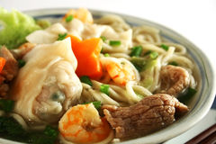 Wanton noodles. Close up photo of a bowl of wanton noodles with pork and shrimp stock photo