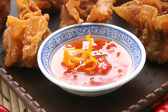 Wantons and bowl of chili  Royalty Free Stock Image
