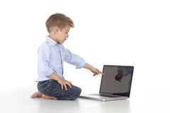 child indicates the laptop Stock Photography