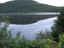 Hill on lake Stock Photography