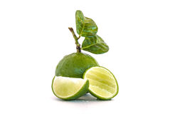 Wapno cytryny owoc z połówką odizolowywającą Fotografia Stock