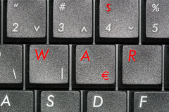 War. This is some symbolic for economic war,with some replaced and painted letters and symbols on the computer keyboard Stock Photo