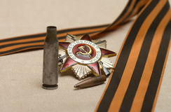 After war. Bullet, shell casing Order of the Patriotic War and the Ribbon of Saint George Royalty Free Stock Photo