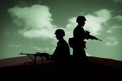 WAR. Silhouettes of any Soldiers in back light Stock Image