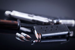 War against terrorism, the concept of freedom of speech and medi. Magazine knife, pen in the form of bullet and blurred gun in the background Stock Photo