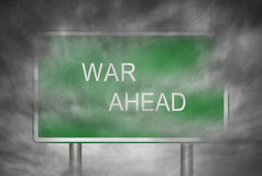 War Ahead. A road sign with text War Ahead in smoke Royalty Free Stock Photos