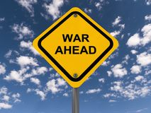 War ahead sign. Yellow war ahead sign with blue sky and cloudscape background royalty free stock photography
