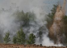 War background. Explosions and smoke in a green forest Royalty Free Stock Images