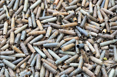 War background of used shells. A lot of utilized cases are heaped after shooting Stock Photo