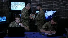 War base, group military IT professionals, on briefing, in stock video footage