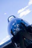 War Bird on the Runway. War bird nose cone and cloudy blue skies Stock Image
