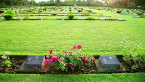 War cemetery,bridge over kwai river death railway grave. Day time stock footage