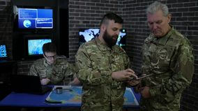 War center, general and officer, in military headquarters, view digital tablet stock video