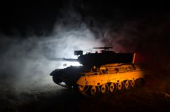 War Concept. Military silhouettes fighting scene on war fog sky background, German tank in action Below Cloudy Skyline At night. A Royalty Free Stock Images
