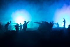 War Concept. Military silhouettes fighting scene on war fog sky background. World War Soldiers Silhouette Below Cloudy Skyline At night royalty free stock photo