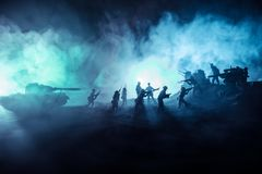 War Concept. Military silhouettes fighting scene on war fog sky background. World War Soldiers Silhouette Below Cloudy Skyline At night royalty free stock photos