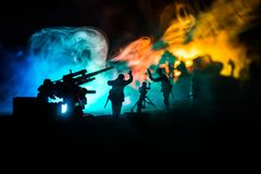 War Concept. Military silhouettes fighting scene on war fog sky background. World War Soldiers Silhouette Below Cloudy Skyline At night royalty free stock image