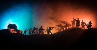 War Concept. Military silhouettes fighting scene on war fog sky background. World War Soldiers Silhouette Below Cloudy Skyline At night royalty free stock images